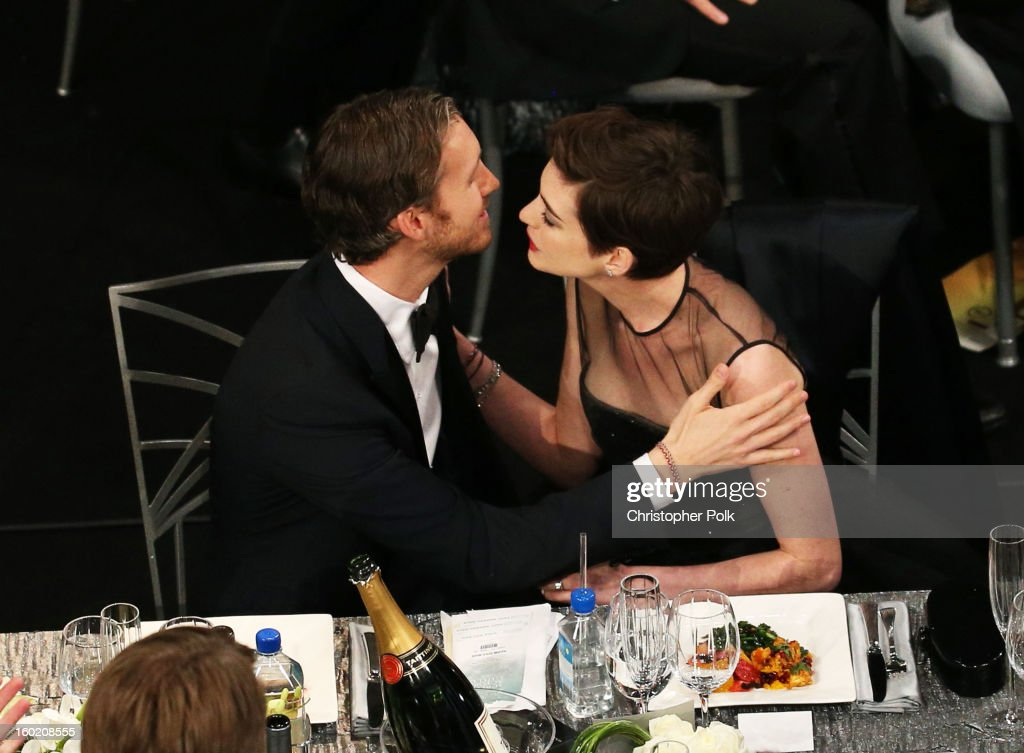 Actress Anne Hathaway (R) and Adam Shulman attend the 19th Annual Screen Actors Guild Awards at The Shrine Auditorium on January 27, 2013 in Los Angeles, California. (Photo by Christopher Polk/WireImage) 23116_012_1101.jpg