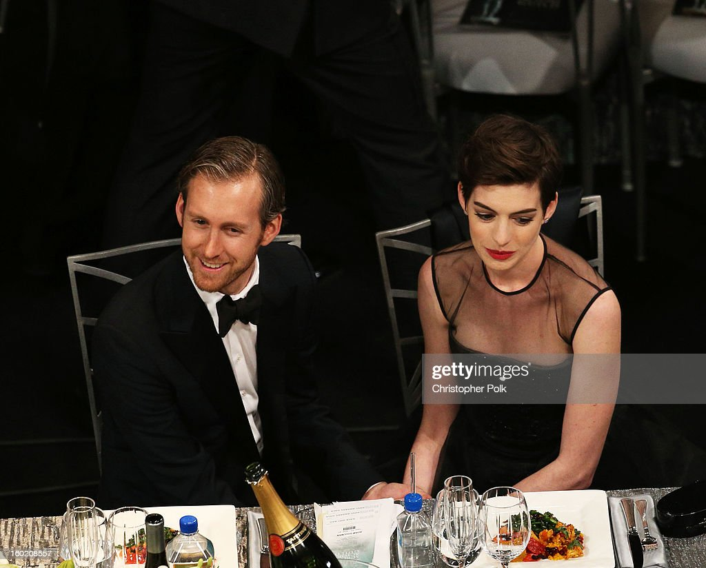 Actress Anne Hathaway (R) and Adam Shulman attend the 19th Annual Screen Actors Guild Awards at The Shrine Auditorium on January 27, 2013 in Los Angeles, California. (Photo by Christopher Polk/WireImage) 23116_012_1014.jpg