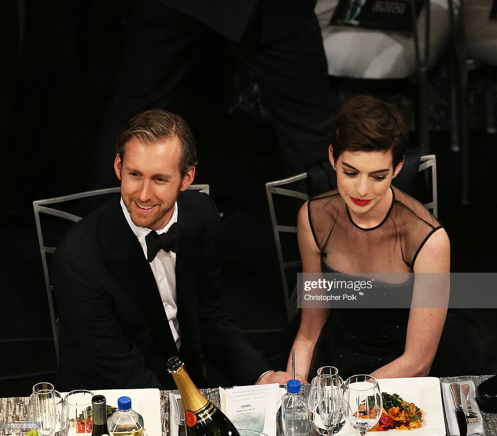 Actress Anne Hathaway (R) and Adam Shulman attend the 19th Annual Screen Actors Guild Awards at The Shrine Auditorium on January 27, 2013 in Los Angeles, California. (Photo by Christopher Polk/WireImage) 23116_012_1016.jpg