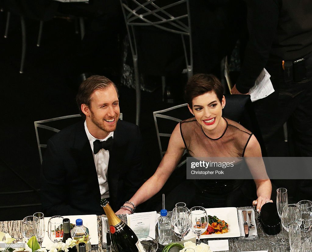 Actress Anne Hathaway (R) and Adam Shulman attend the 19th Annual Screen Actors Guild Awards at The Shrine Auditorium on January 27, 2013 in Los Angeles, California. (Photo by Christopher Polk/WireImage) 23116_012_1018.jpg