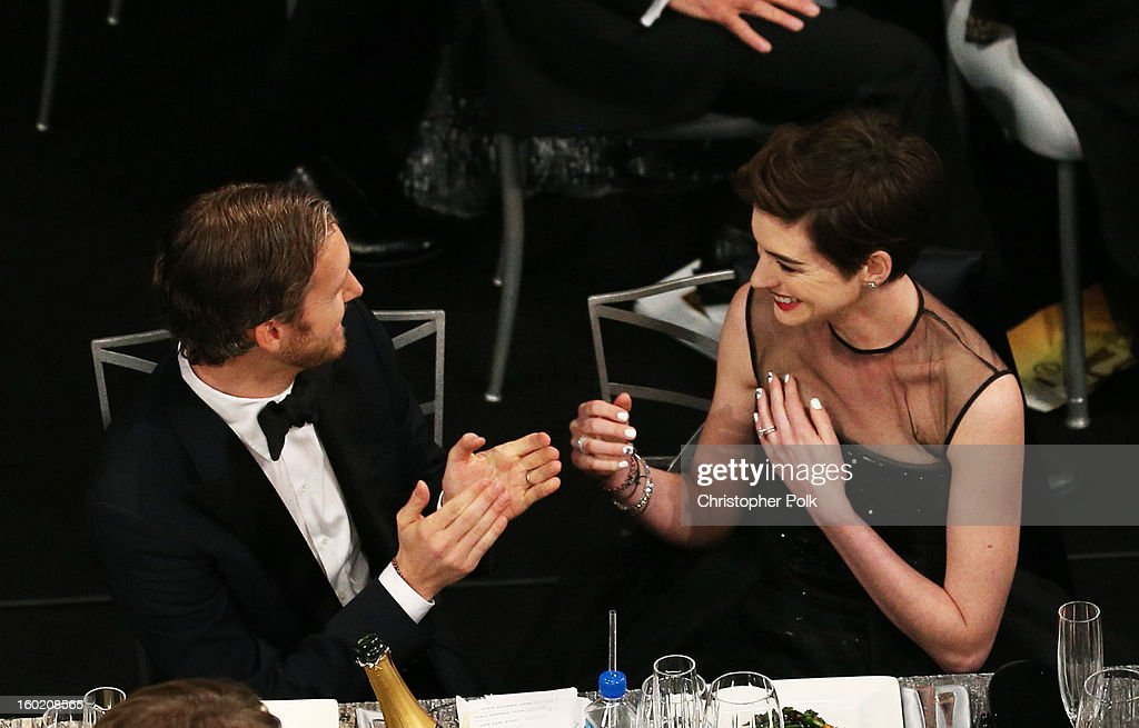 Actress Anne Hathaway (R) and Adam Shulman attend the 19th Annual Screen Actors Guild Awards at The Shrine Auditorium on January 27, 2013 in Los Angeles, California. (Photo by Christopher Polk/WireImage) 23116_012_1093.jpg