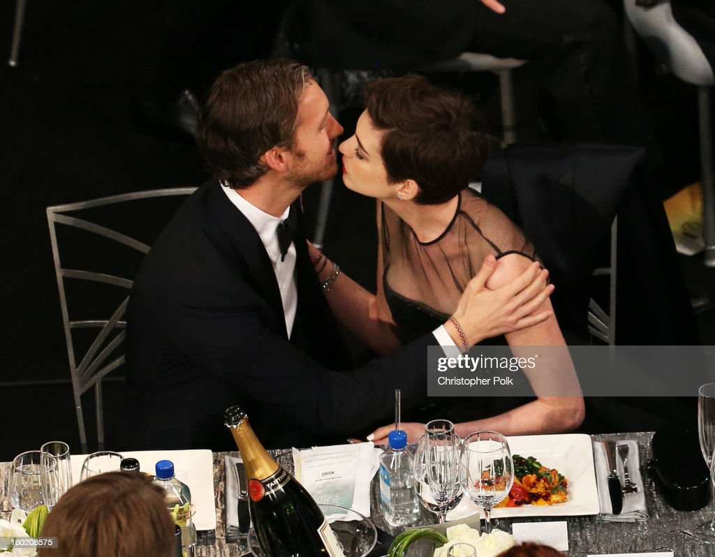 Actress Anne Hathaway (R) and Adam Shulman attend the 19th Annual Screen Actors Guild Awards at The Shrine Auditorium on January 27, 2013 in Los Angeles, California. (Photo by Christopher Polk/WireImage) 23116_012_1102.jpg