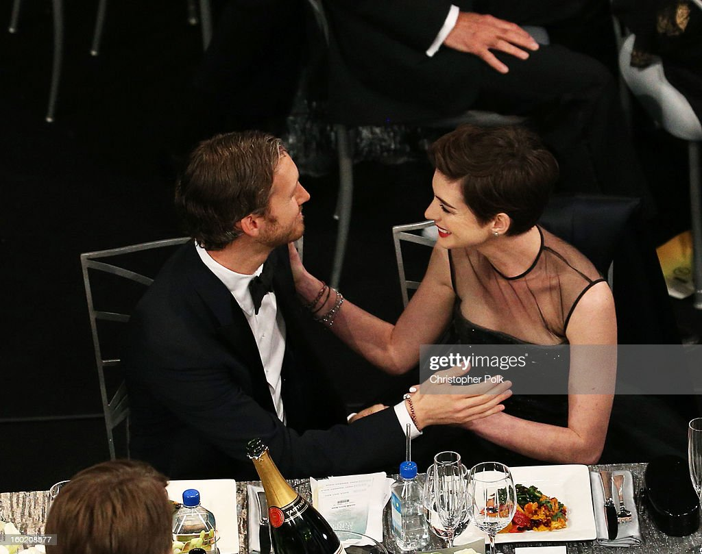 Actress Anne Hathaway (R) and Adam Shulman attend the 19th Annual Screen Actors Guild Awards at The Shrine Auditorium on January 27, 2013 in Los Angeles, California. (Photo by Christopher Polk/WireImage) 23116_012_1098.jpg