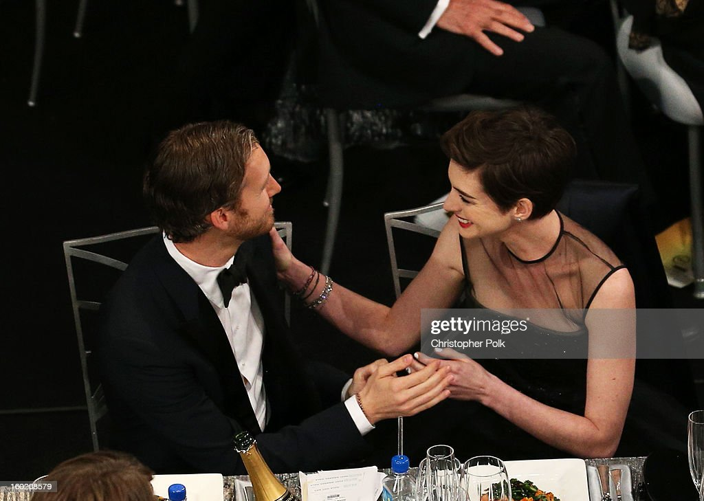 Actress Anne Hathaway (R) and Adam Shulman attend the 19th Annual Screen Actors Guild Awards at The Shrine Auditorium on January 27, 2013 in Los Angeles, California. (Photo by Christopher Polk/WireImage) 23116_012_1097.jpg
