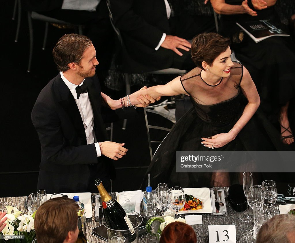 Actress Anne Hathaway (R) and Adam Shulman attend the 19th Annual Screen Actors Guild Awards at The Shrine Auditorium on January 27, 2013 in Los Angeles, California. (Photo by Christopher Polk/WireImage) 23116_012_1106.jpg