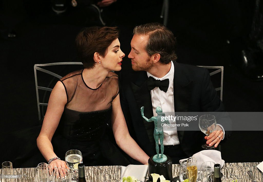 Actress Anne Hathaway (L) and Adam Shulman attend the 19th Annual Screen Actors Guild Awards at The Shrine Auditorium on January 27, 2013 in Los Angeles, California. (Photo by Christopher Polk/WireImage) 23116_012_1309.jpg