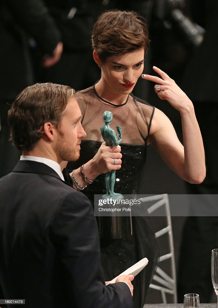 Actress Anne Hathaway (R) and Adam Shulman attend the 19th Annual Screen Actors Guild Awards at The Shrine Auditorium on January 27, 2013 in Los Angeles, California. (Photo by Christopher Polk/WireImage) 23116_012_2192.jpg