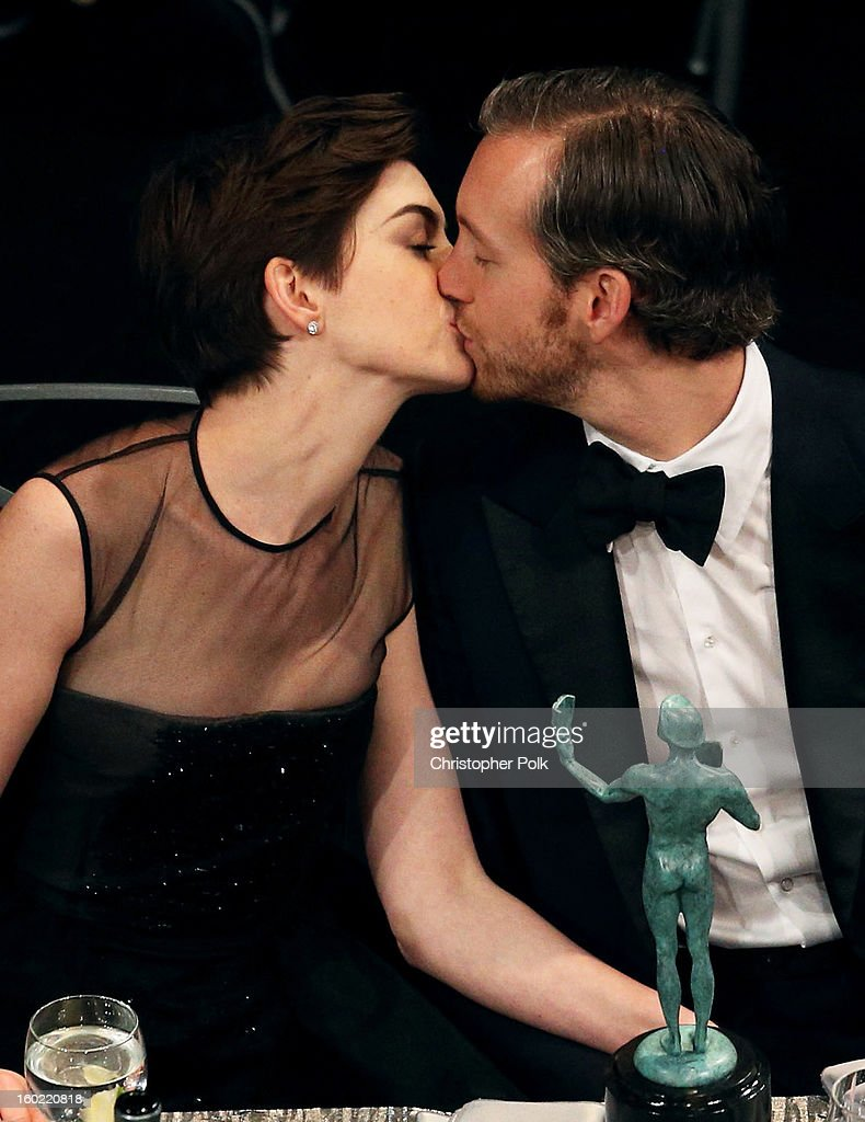 Actress Anne Hathaway (L) and Adam Shulman attend the 19th Annual Screen Actors Guild Awards at The Shrine Auditorium on January 27, 2013 in Los Angeles, California. (Photo by Christopher Polk/WireImage) 23116_012_1311.jpg