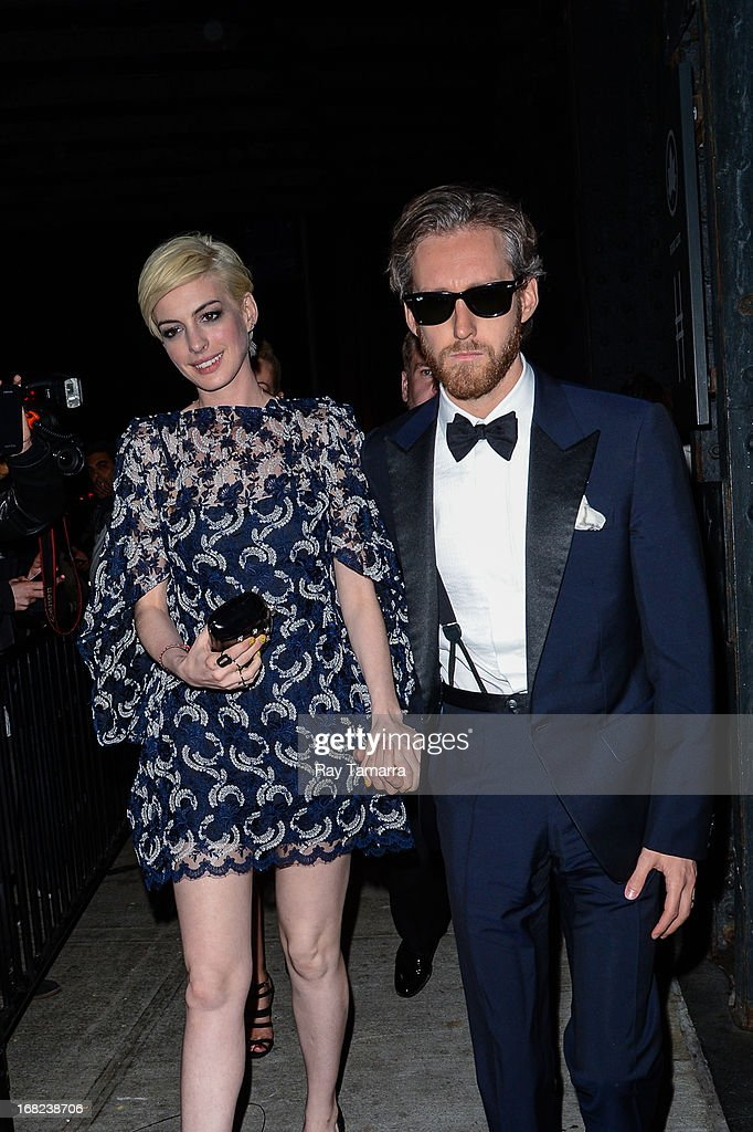 Actress Anne Hathaway (L) and Adam Shulman enter the 'PUNK: Chaos To Couture' Costume Institute Gala after party at the Standard Hotel on May 6, 2013 in New York City.