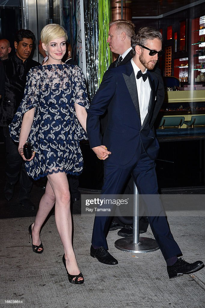 Actress Anne Hathaway (L) and Adam Shulman leave the 'PUNK: Chaos To Couture' Costume Institute Gala after party at the Standard Hotel on May 6, 2013 in New York City.