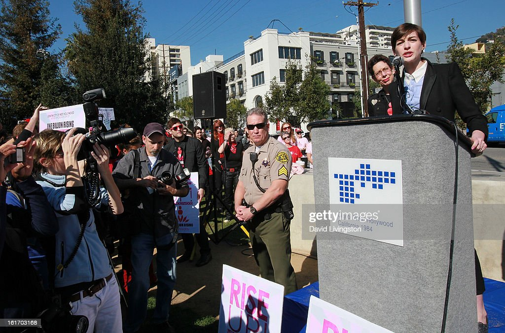 Actress Anne Hathaway (R) and City of West Hollywood Mayor Pro Tempore Abbe Land attend the kick-off for One Billion Rising in West Hollywood on February 14, 2013 in West Hollywood, California.
