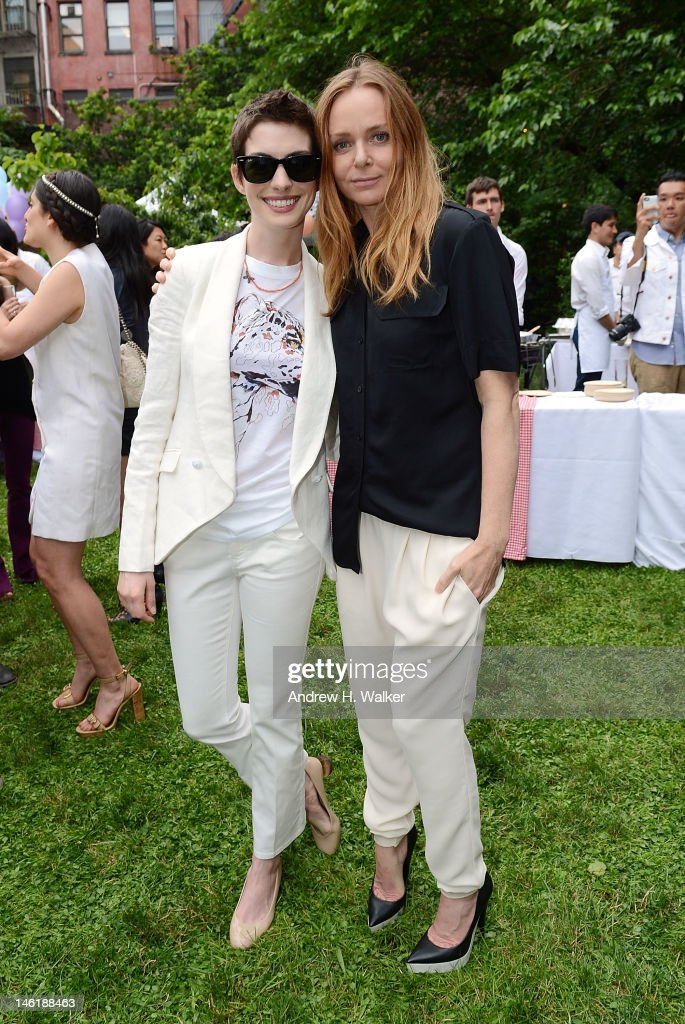 Actress <a gi-track='captionPersonalityLinkClicked' href=/galleries/search?phrase=Anne+Hathaway+-+Actress&family=editorial&specificpeople=11647173 ng-click='$event.stopPropagation()'>Anne Hathaway</a> and fashion designer Stella McCartney attend the Stella McCartney Resort 2013 Presentation on June 11, 2012 in New York City.