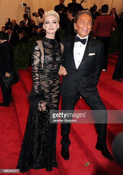 Actress Anne Hathaway and Fashion designer Valentino attends the Costume Institute Gala for the 'PUNK Chaos to Couture' exhibition at the...