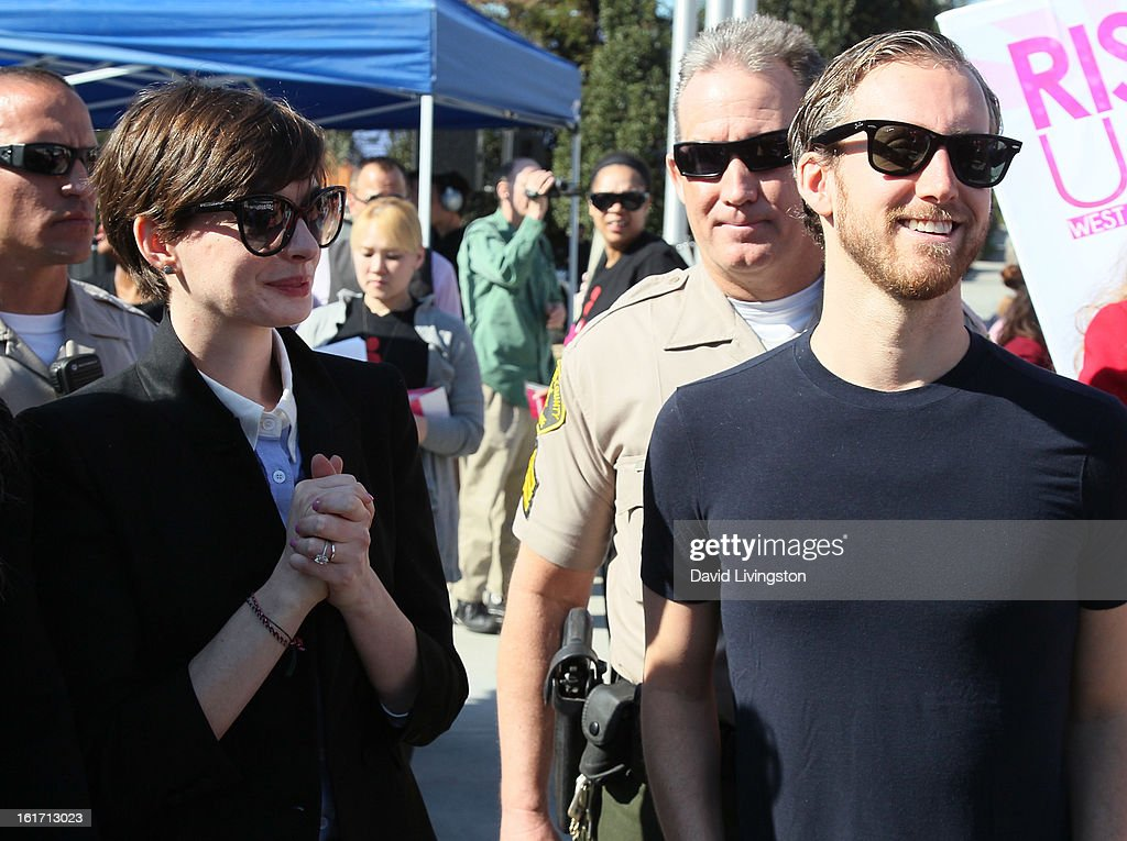Actress Anne Hathaway (L) and husband actor Adam Shulman attend the kick-off for One Billion Rising in West Hollywood on February 14, 2013 in West Hollywood, California.
