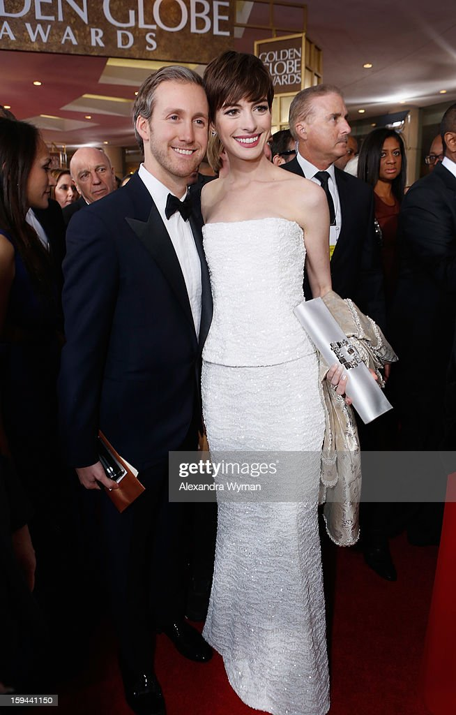 Actress Anne Hathaway (R) and husband Adam Shulman arrive at the 70th Annual Golden Globe Awards held at The Beverly Hilton Hotel on January 13, 2013 in Beverly Hills, California.