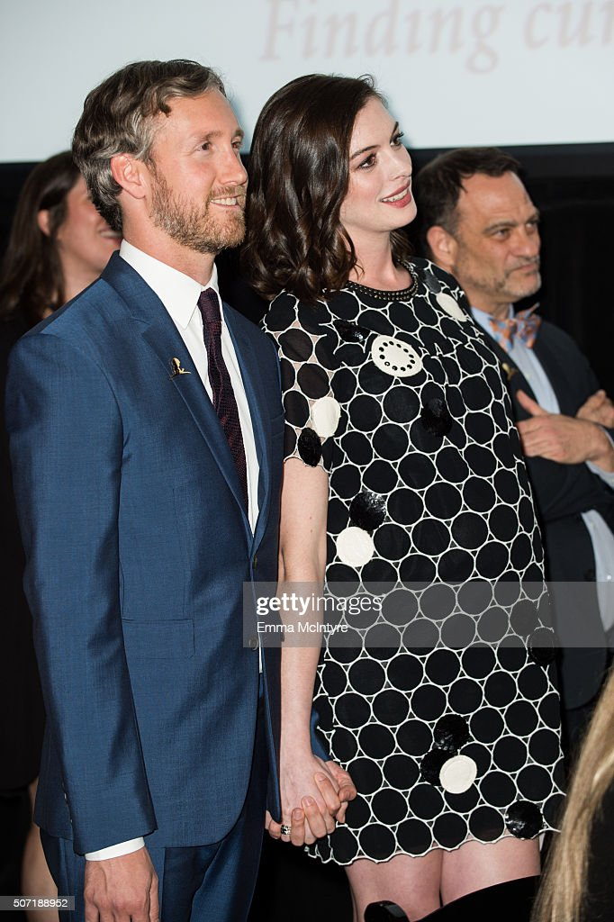 Actress <a gi-track='captionPersonalityLinkClicked' href=/galleries/search?phrase=Anne+Hathaway+-+Actress&family=editorial&specificpeople=11647173 ng-click='$event.stopPropagation()'>Anne Hathaway</a> and husband <a gi-track='captionPersonalityLinkClicked' href=/galleries/search?phrase=Adam+Shulman&family=editorial&specificpeople=4682498 ng-click='$event.stopPropagation()'>Adam Shulman</a> attend the LA Art Show and Los Angeles Fine Art Show's 2016 Opening Night Premiere Party Benefiting St. Jude Children's Research Hospitalat Los Angeles Convention Center on January 27, 2016 in Los Angeles, California.