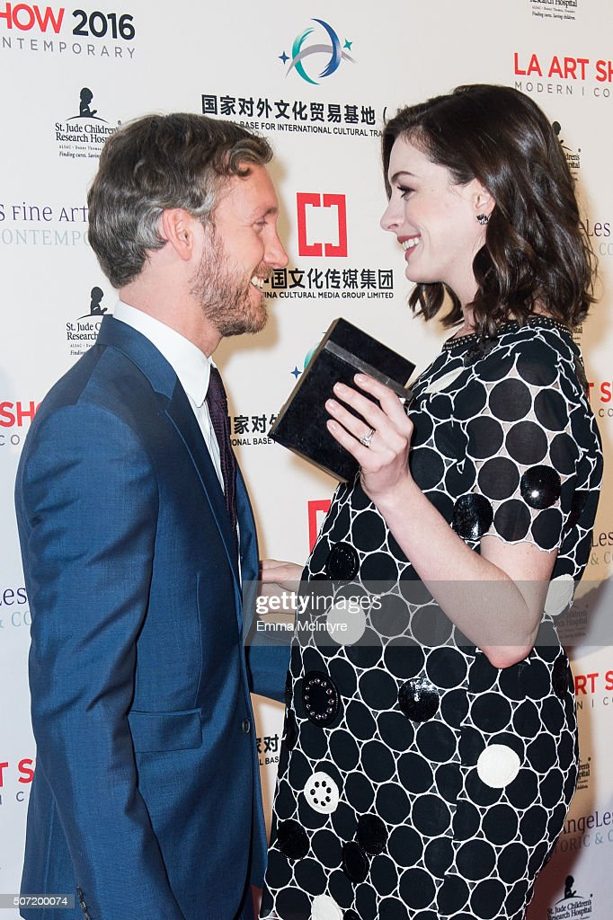 Actress <a gi-track='captionPersonalityLinkClicked' href=/galleries/search?phrase=Anne+Hathaway+-+Actriz&family=editorial&specificpeople=11647173 ng-click='$event.stopPropagation()'>Anne Hathaway</a> and husband <a gi-track='captionPersonalityLinkClicked' href=/galleries/search?phrase=Adam+Shulman&family=editorial&specificpeople=4682498 ng-click='$event.stopPropagation()'>Adam Shulman</a> attend the LA Art Show And Los Angeles Fine Art Show's 2016 Opening Night Premiere Party Benefiting St. Jude Children's Research Hospitalat Los Angeles Convention Center on January 27, 2016 in Los Angeles, California.