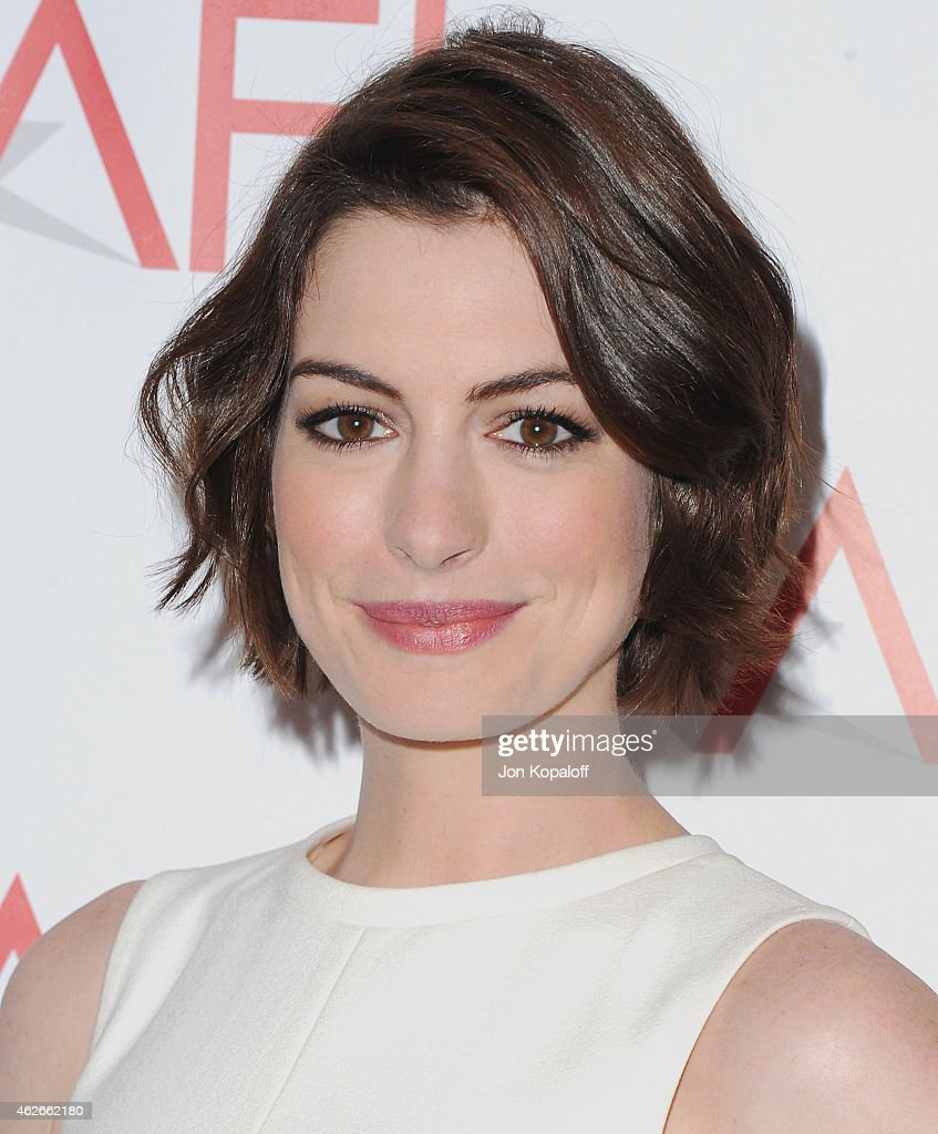 Actress <a gi-track='captionPersonalityLinkClicked' href=/galleries/search?phrase=Anne+Hathaway+-+Atriz&family=editorial&specificpeople=11647173 ng-click='$event.stopPropagation()'>Anne Hathaway</a> arrives at the 15th Annual AFI Awards at Four Seasons Hotel Los Angeles at Beverly Hills on January 9, 2015 in Beverly Hills, California.