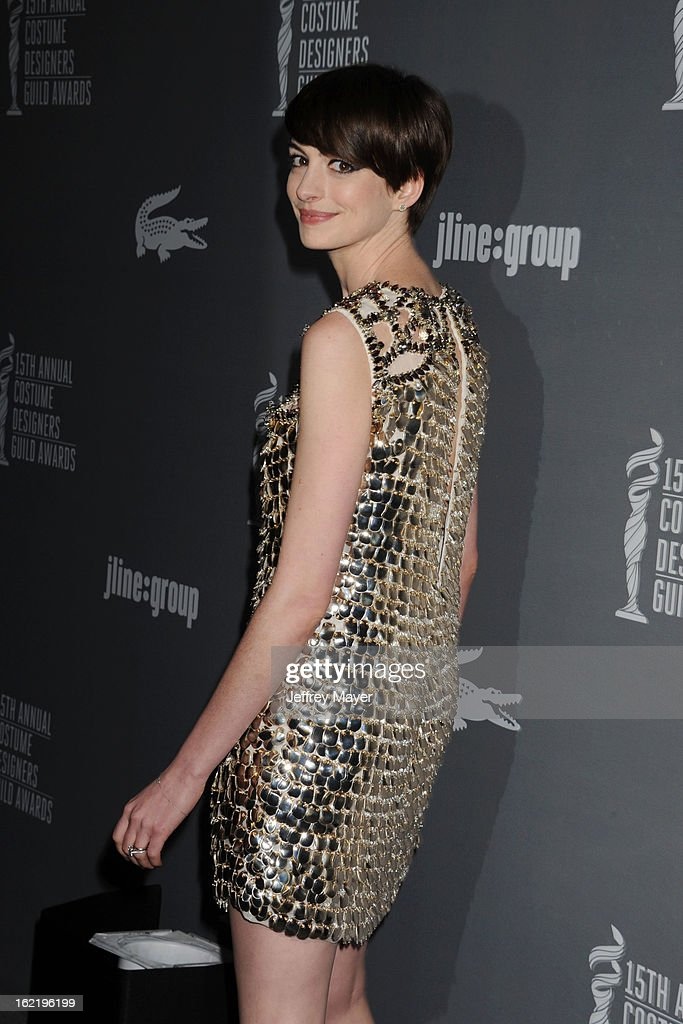 Actress Anne Hathaway arrives at the 15th Annual Costume Designers Guild Awards at The Beverly Hilton Hotel on February 19, 2013 in Beverly Hills, California.