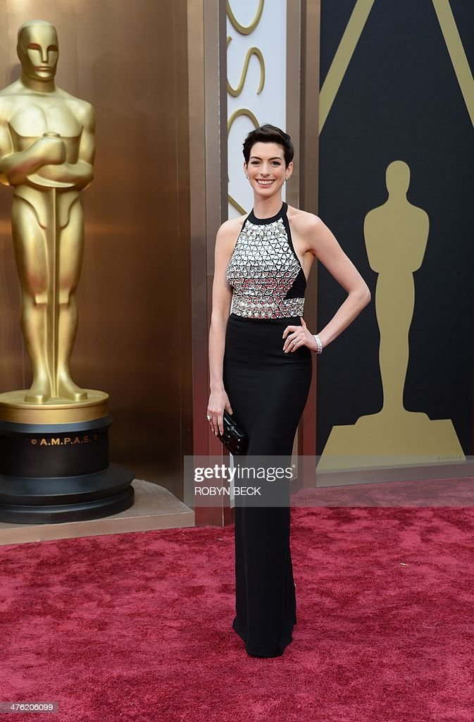 Actress Anne Hathaway arrives on the red carpet for the 86th Academy Awards on March 2nd, 2014 in Hollywood, California. AFP PHOTO / Robyn BECK