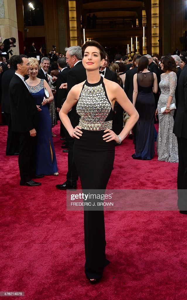 Actress Anne Hathaway arrives on the red carpet for the 86th Academy Awards on March 2nd, 2014 in Hollywood, California.