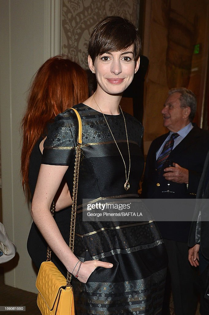 Actress <a gi-track='captionPersonalityLinkClicked' href=/galleries/search?phrase=Anne+Hathaway+-+Atriz&family=editorial&specificpeople=11647173 ng-click='$event.stopPropagation()'>Anne Hathaway</a> attends at the BAFTA Los Angeles 2013 Awards Season Tea Party held at the Four Seasons Hotel Los Angeles on January 12, 2013 in Los Angeles, California.