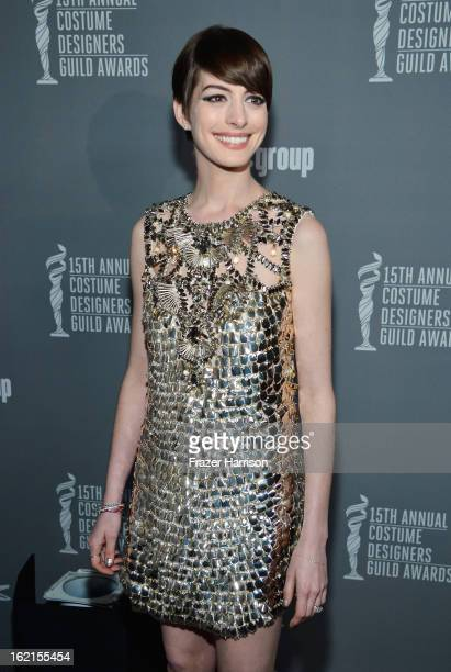 Actress Anne Hathaway attends the 15th Annual Costume Designers Guild Awards with presenting sponsor Lacoste at The Beverly Hilton Hotel on February...