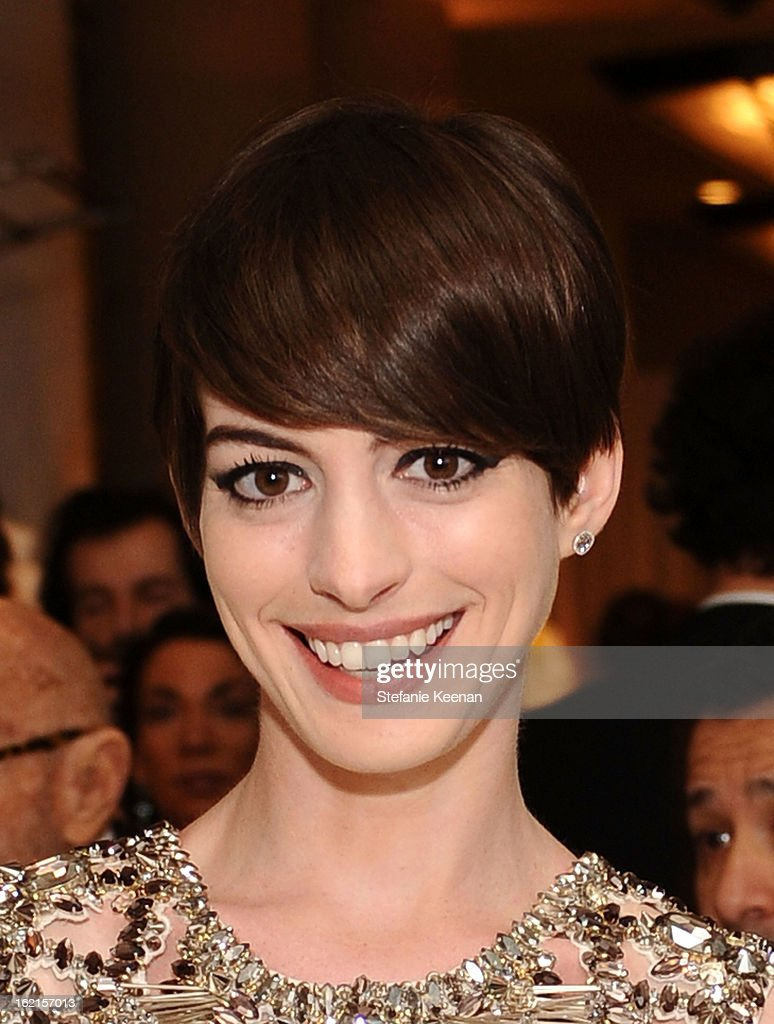 Actress <a gi-track='captionPersonalityLinkClicked' href=/galleries/search?phrase=Anne+Hathaway+-+Atriz&family=editorial&specificpeople=11647173 ng-click='$event.stopPropagation()'>Anne Hathaway</a> attends the 15th Annual Costume Designers Guild Awards with presenting sponsor Lacoste at The Beverly Hilton Hotel on February 19, 2013 in Beverly Hills, California.