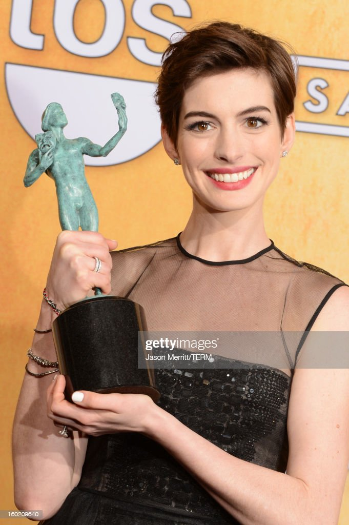 Actress <a gi-track='captionPersonalityLinkClicked' href=/galleries/search?phrase=Anne+Hathaway+-+Actress&family=editorial&specificpeople=11647173 ng-click='$event.stopPropagation()'>Anne Hathaway</a> attends the 19th Annual Screen Actors Guild Awards at The Shrine Auditorium on January 27, 2013 in Los Angeles, California. (Photo by Jason Merritt/WireImage) 23116_014_3223.jpg