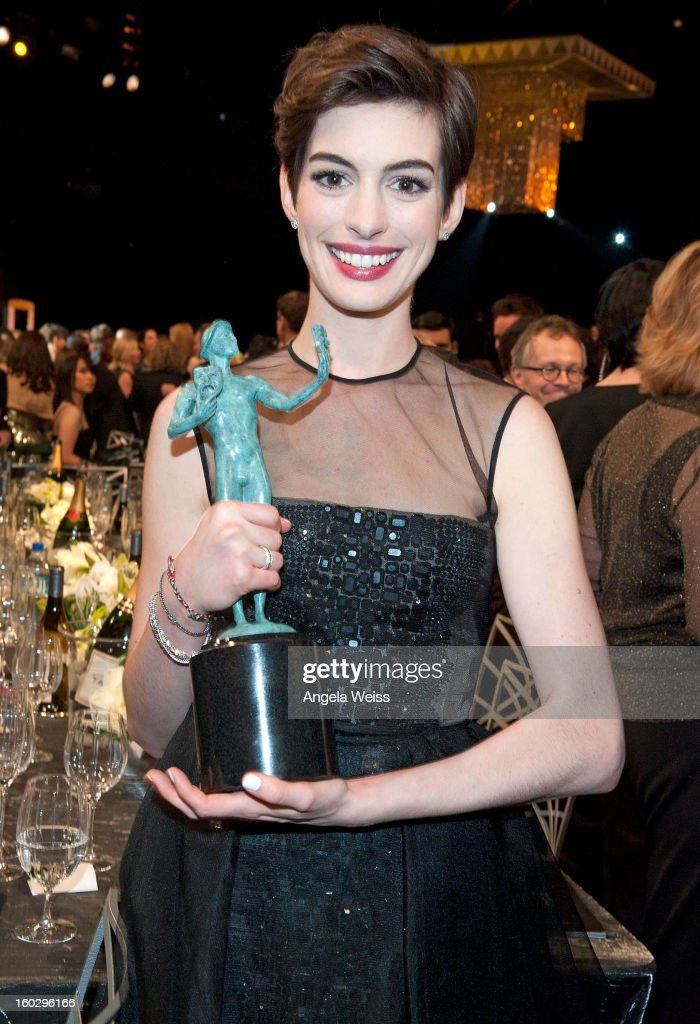 Actress <a gi-track='captionPersonalityLinkClicked' href=/galleries/search?phrase=Anne+Hathaway+-+Actriz&family=editorial&specificpeople=11647173 ng-click='$event.stopPropagation()'>Anne Hathaway</a> attends the 19th Annual Screen Actors Guild Awards at The Shrine Auditorium on January 27, 2013 in Los Angeles, California.