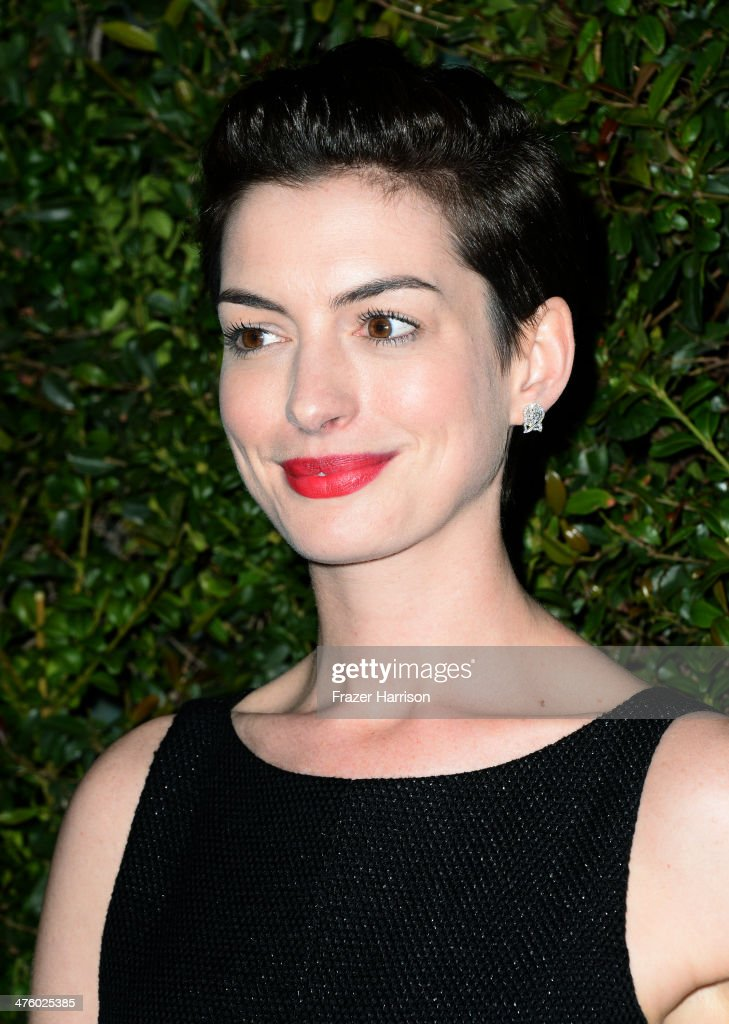 Actress Anne Hathaway attends the Chanel and Charles Finch Pre-Oscar Dinner at Madeo Restaurant on March 1, 2014 in Los Angeles, California.
