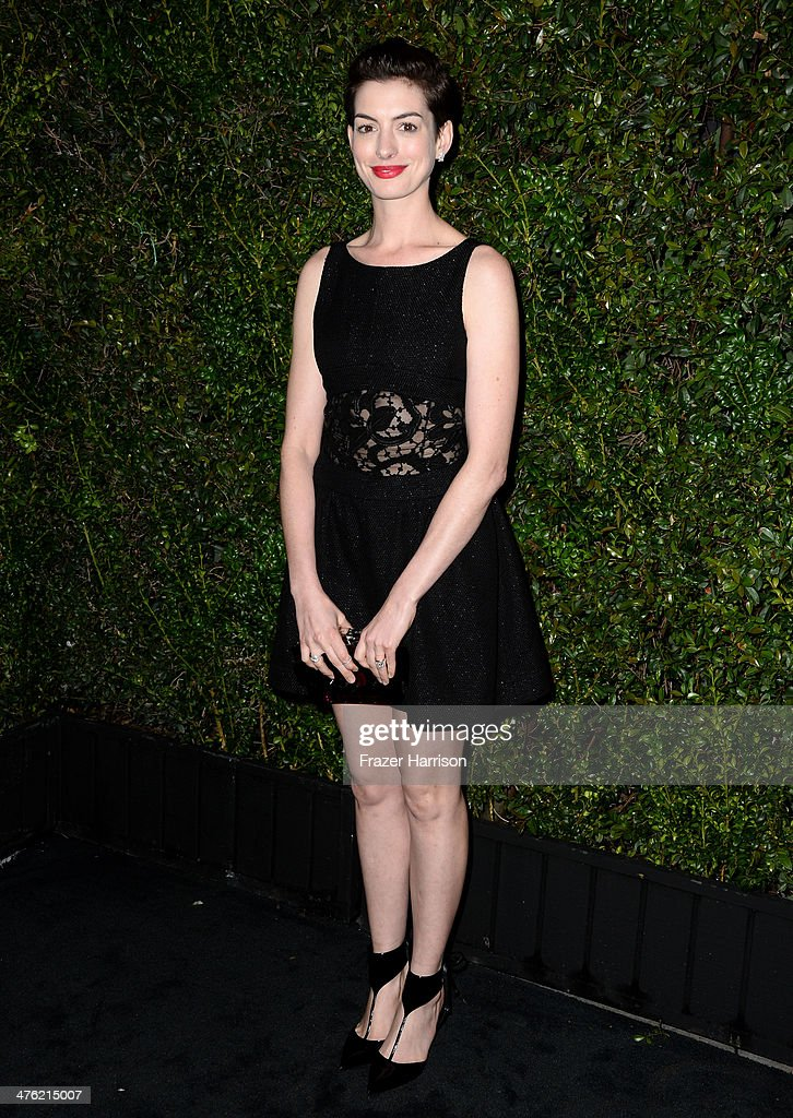 Actress <a gi-track='captionPersonalityLinkClicked' href=/galleries/search?phrase=Anne+Hathaway+-+Actress&family=editorial&specificpeople=11647173 ng-click='$event.stopPropagation()'>Anne Hathaway</a> attends the Chanel and Charles Finch Pre-Oscar Dinner at Madeo Restaurant on March 1, 2014 in Los Angeles, California.
