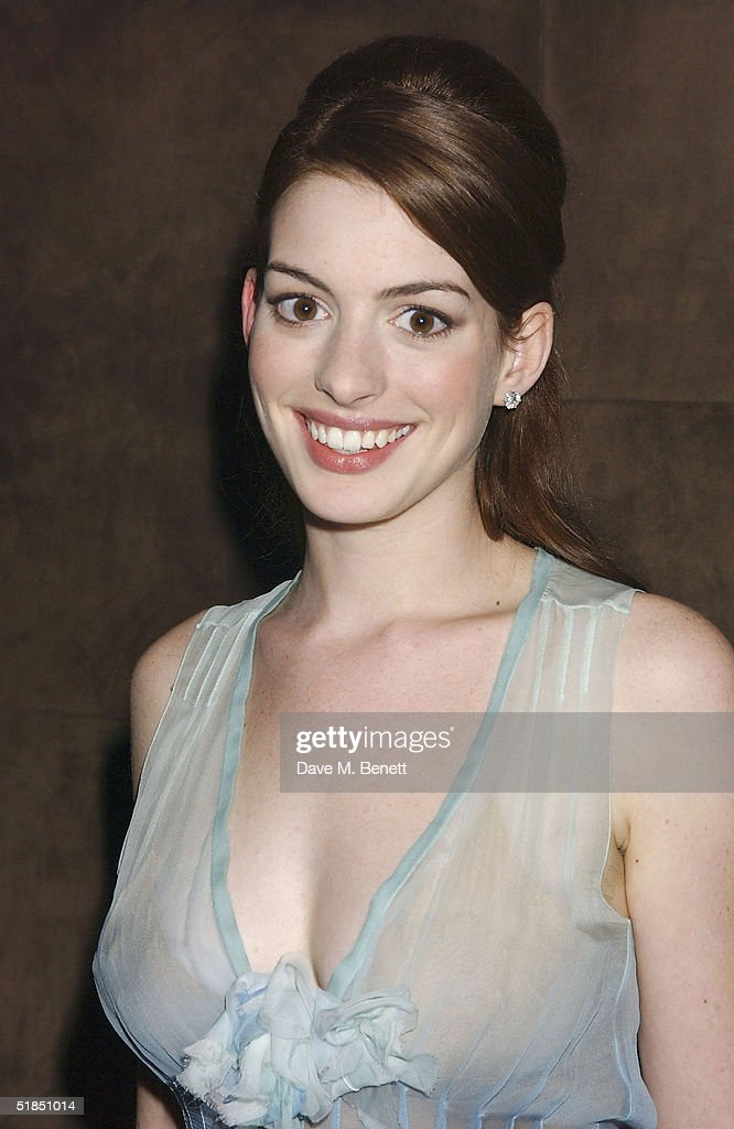 Actress <a gi-track='captionPersonalityLinkClicked' href=/galleries/search?phrase=Anne+Hathaway+-+Actress&family=editorial&specificpeople=11647173 ng-click='$event.stopPropagation()'>Anne Hathaway</a> attends the 'Ella Enchanted' movie afterparty at the Rouge club on December 11, 2004 in London.