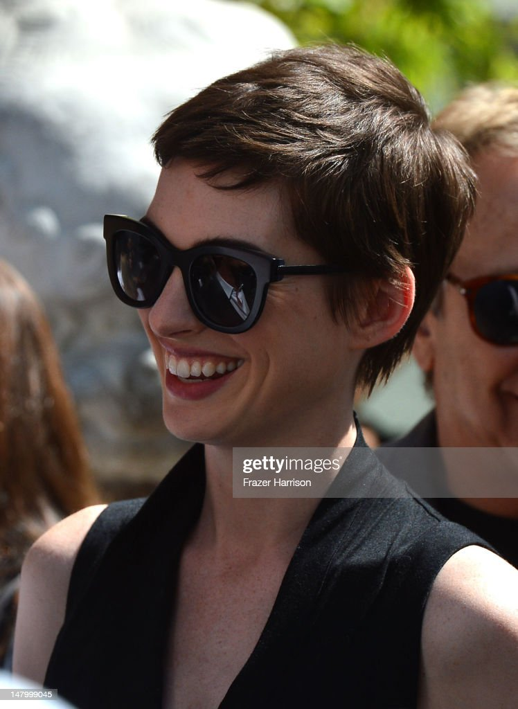 Actress <a gi-track='captionPersonalityLinkClicked' href=/galleries/search?phrase=Anne+Hathaway+-+Actress&family=editorial&specificpeople=11647173 ng-click='$event.stopPropagation()'>Anne Hathaway</a> attends the Hand and Footprint Ceremony for Director, Writer, Producer Christopher Nolan, at Grauman's Chinese Theatre on July 7, 2012 in Hollywood, California.