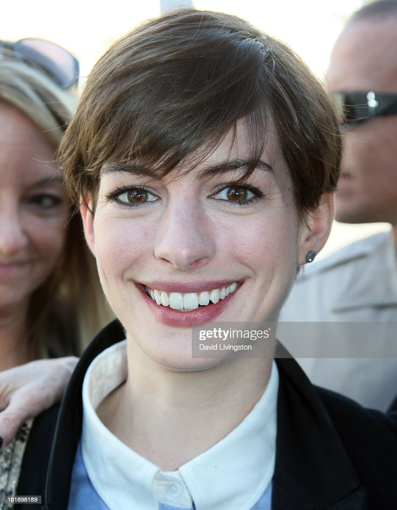 Actress <a gi-track='captionPersonalityLinkClicked' href=/galleries/search?phrase=Anne+Hathaway+-+Schauspielerin&family=editorial&specificpeople=11647173 ng-click='$event.stopPropagation()'>Anne Hathaway</a> attends the kick-off for One Billion Rising in West Hollywood on February 14, 2013 in West Hollywood, California.
