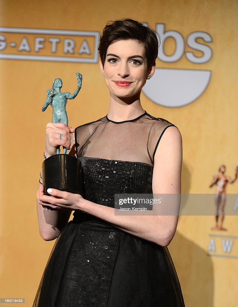 Actress <a gi-track='captionPersonalityLinkClicked' href=/galleries/search?phrase=Anne+Hathaway+-+Actrice&family=editorial&specificpeople=11647173 ng-click='$event.stopPropagation()'>Anne Hathaway</a> attends the19th Annual Screen Actors Guild Awards Press Room at The Shrine Auditorium on January 27, 2013 in Los Angeles, California.