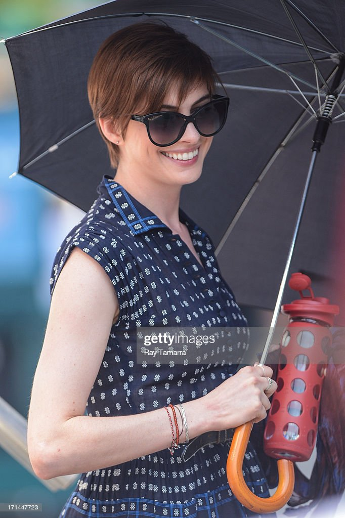Actress <a gi-track='captionPersonalityLinkClicked' href=/galleries/search?phrase=Anne+Hathaway+-+Atriz&family=editorial&specificpeople=11647173 ng-click='$event.stopPropagation()'>Anne Hathaway</a> enters the 'Song One' movie set in the Lower East Side on June 24, 2013 in New York City.