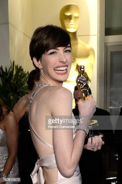 Actress Anne Hathaway holds her trophy for Best Supporting Actress for her performance in 'Les Misérables ' as she attends the Oscars Governors Ball...