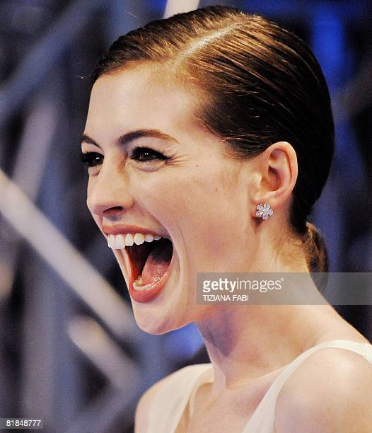 US actress Anne Hathaway laughs as she arrives at the cinema in central Rome on July 7 2008 for the premiere of the film 'Get Smart' AFP PHOTO/...
