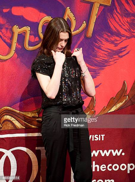 Actress Anne Hathaway looks down her blouse during a skit as she is celebrated as Harvard University's Hasty Pudding Theatricals Woman of the Year in...