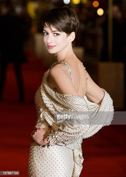 US Actress Anne Hathaway poses for photographers on the red carpet ahead of the world premiere of 'Les Miserables' in central London on December 5...