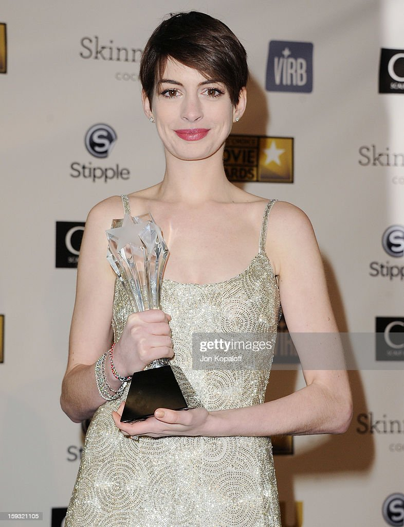 Actress Anne Hathaway poses in the press room at the 18th Annual Critics' Choice Movie Awards at Barker Hangar on January 10, 2013 in Santa Monica, California.