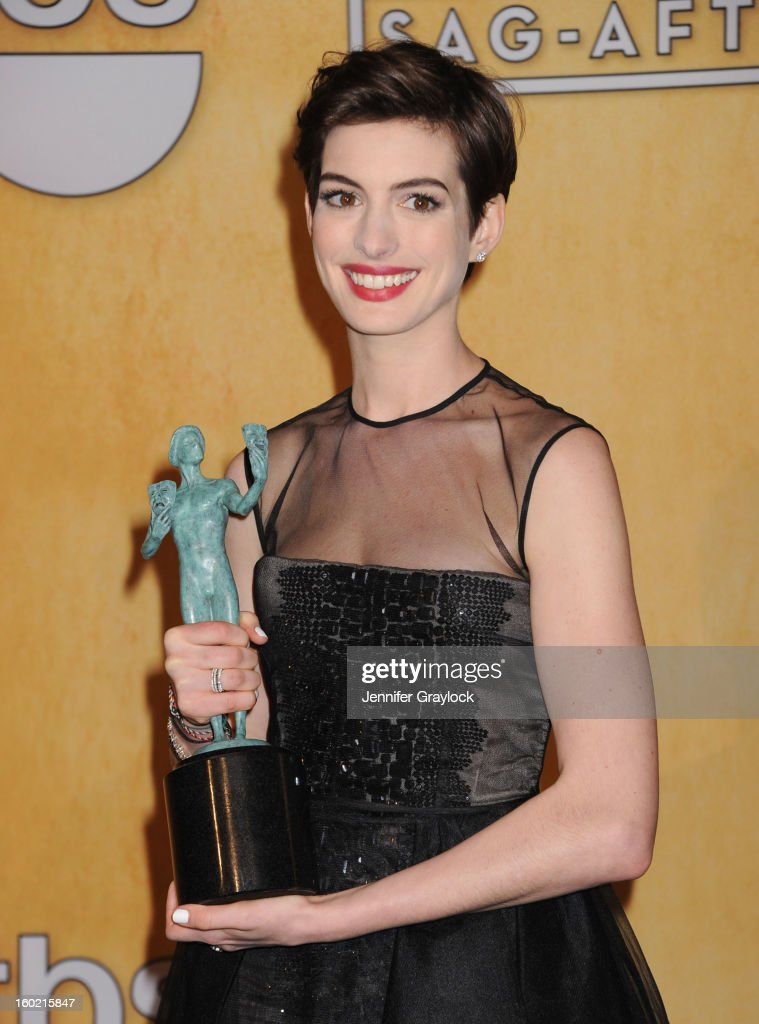 Actress <a gi-track='captionPersonalityLinkClicked' href=/galleries/search?phrase=Anne+Hathaway+-+Actress&family=editorial&specificpeople=11647173 ng-click='$event.stopPropagation()'>Anne Hathaway</a> poses in the press room at the 19th Annual Screen Actors Guild Awards at The Shrine Auditorium on January 27, 2013 in Los Angeles, California.