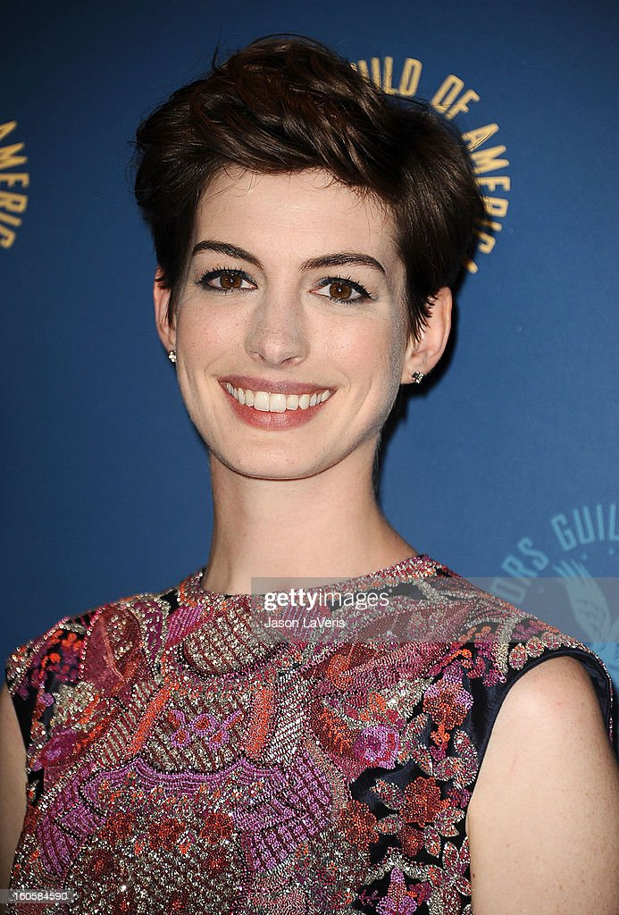Actress <a gi-track='captionPersonalityLinkClicked' href=/galleries/search?phrase=Anne+Hathaway+-+Sk%C3%A5despelerska&family=editorial&specificpeople=11647173 ng-click='$event.stopPropagation()'>Anne Hathaway</a> poses in the press room at the 65th annual Directors Guild Of America Awards at The Ray Dolby Ballroom at Hollywood & Highland Center on February 2, 2013 in Hollywood, California.