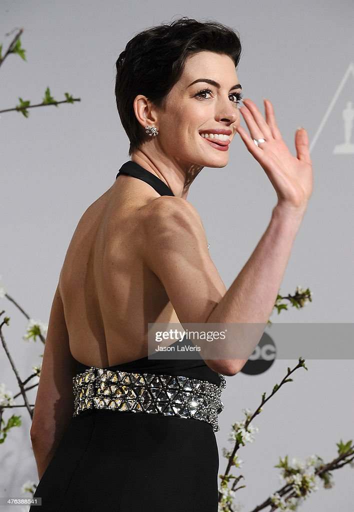 Actress Anne Hathaway poses in the press room at the 86th annual Academy Awards at Dolby Theatre on March 2, 2014 in Hollywood, California.