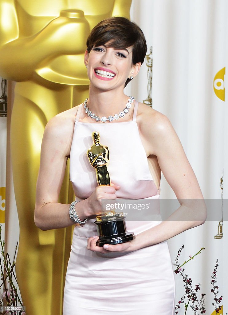 Actress <a gi-track='captionPersonalityLinkClicked' href=/galleries/search?phrase=Anne+Hathaway+-+Actress&family=editorial&specificpeople=11647173 ng-click='$event.stopPropagation()'>Anne Hathaway</a> poses in the press room during the Oscars at Loews Hollywood Hotel on February 24, 2013 in Hollywood, California.