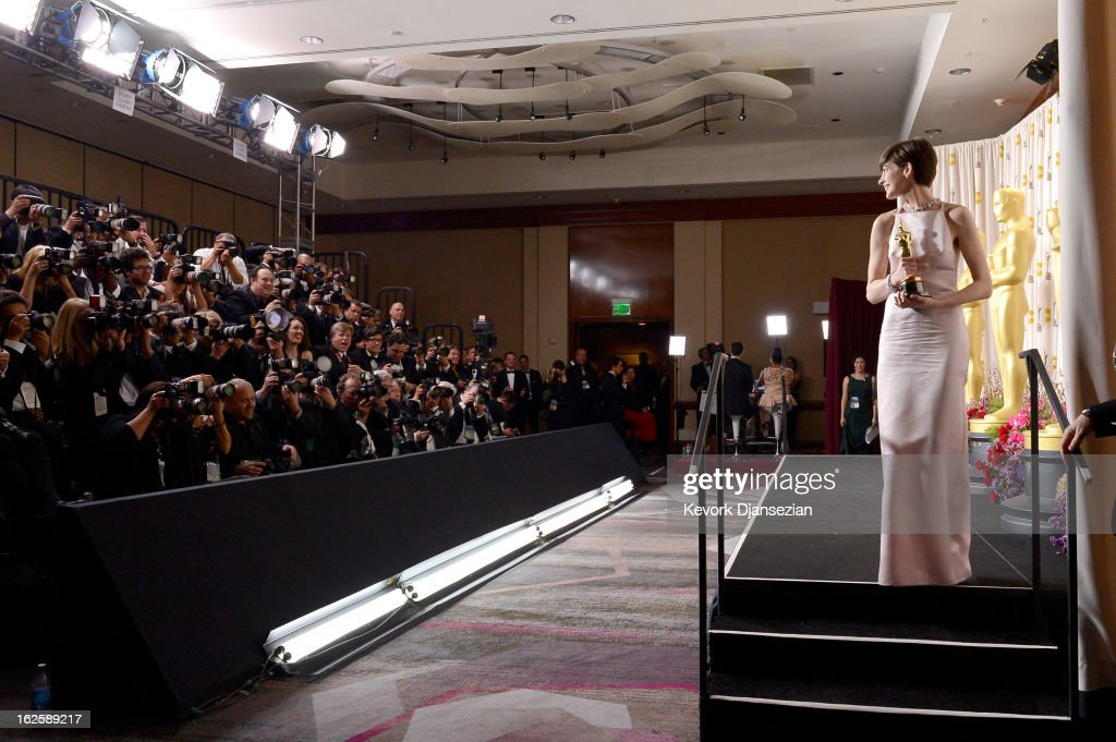 Actress Anne Hathaway poses with the Best Supporting Actress award for 'Les Miserables' in the press room during the Oscars held at Loews Hollywood Hotel on February 24, 2013 in Hollywood, California.