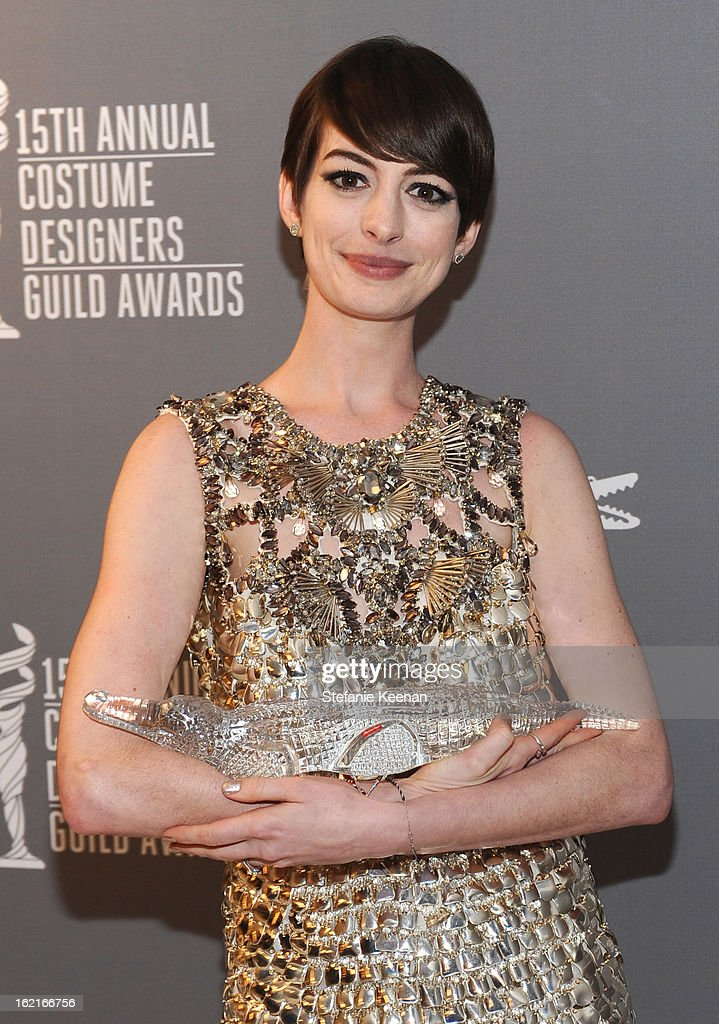 Actress <a gi-track='captionPersonalityLinkClicked' href=/galleries/search?phrase=Anne+Hathaway+-+Actress&family=editorial&specificpeople=11647173 ng-click='$event.stopPropagation()'>Anne Hathaway</a> poses with the Lacoste Spotlight Award during the 15th Annual Costume Designers Guild Awards with presenting sponsor Lacoste at The Beverly Hilton Hotel on February 19, 2013 in Beverly Hills, California.