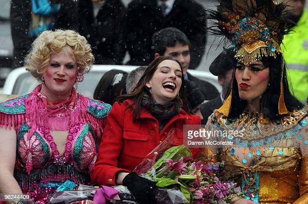 Actress Anne Hathaway rides in a car with Hasty Pudding Theatricals actors Clifford Murray and Derek Mueller January 28 2010 in Cambridge...