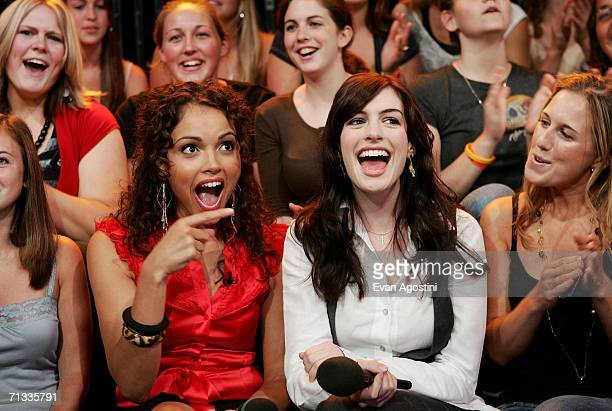 Actress Anne Hathaway sits with VJ Susie Castillo and her cousin Meredith Shevory during an appearance on MTV's Total Request Live at MTV Studios...